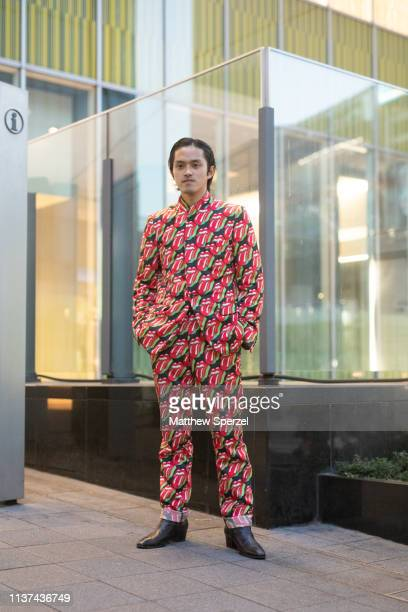 A guest is seen wearing Comme des Garcons during the Amazon Fashion Week TOKYO 2019 A/W on March 21 2019 in Tokyo Japan