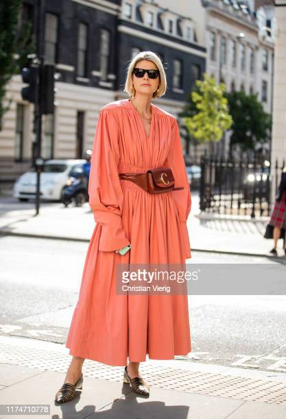 A guest is seen wearing coralline dress Chloe bag outside Toga during London Fashion Week September 2019 on September 14 2019 in London England