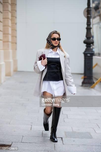 Guest is seen wearing corset, head scarf, blazer, white button shirt worn as a dress, black boots outside Victoria/Tomas during Paris Fashion Week -...