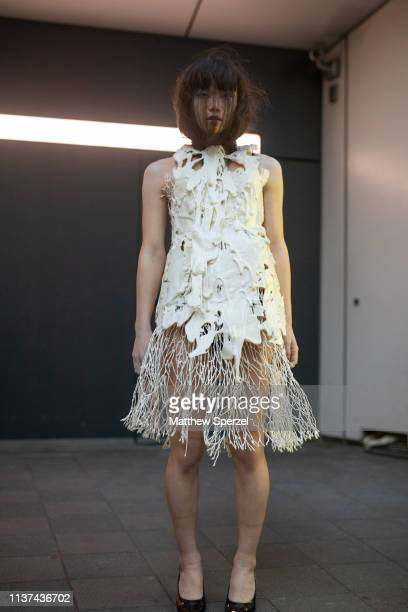 A guest is seen wearing couture sculpted dress during the Amazon Fashion Week TOKYO 2019 A/W on March 21 2019 in Tokyo Japan