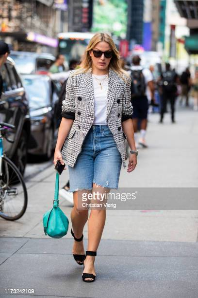 A guest is seen wearing cropped denim shorts outside Tibi during New York Fashion Week September 2019 on September 08 2019 in New York City