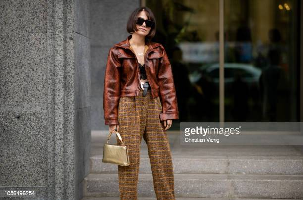 A guest is seen wearing cropped jacket with snake print brown high waist plaid pants during MercedesBenz Tbilisi Fashion Week on November 2 2018 in...