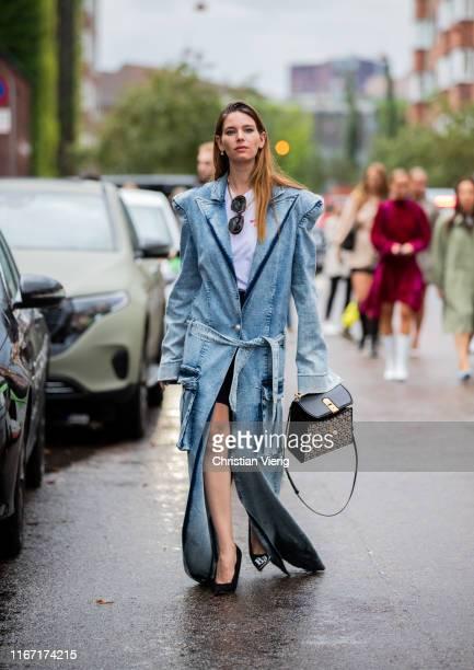 A guest is seen wearing denim coat outside Saks Potts during Copenhagen Fashion Week Spring/Summer 2020 on August 08 2019 in Copenhagen Denmark