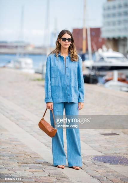 Guest is seen wearing denim jacket and jeans outside Rodebjer during Copenhagen Fashion Week Spring/Summer 2020 on August 07, 2019 in Copenhagen,...