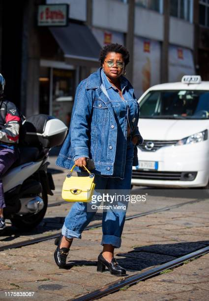 A guest is seen wearing denim jacket and jeans yellow bag outside the Pucci during Milan Fashion Week Spring/Summer 2020 on September 19 2019 in...