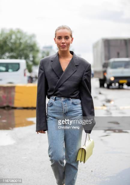 Guest is seen wearing denim jeans outside Baum und Pferdgarten during Copenhagen Fashion Week Spring/Summer 2020 on August 08, 2019 in Copenhagen,...