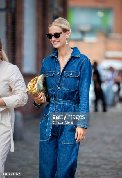 Guest is seen wearing denim overall outside Rodebjer during Copenhagen Fashion Week Spring/Summer 2020 on August 07, 2019 in Copenhagen, Denmark.