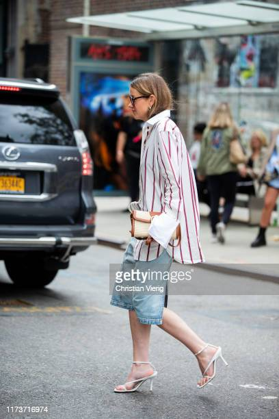 Guest is seen wearing denim skirt, striped button shirt outside Gabriela Hearst during New York Fashion Week September 2019 on September 10, 2019 in...