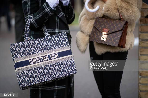 A guest is seen wearing Dior bag and Louis Vuitton bag outside By Malene Birger during the Copenhagen Fashion Week Autumn/Winter 2019 Day 3 on...