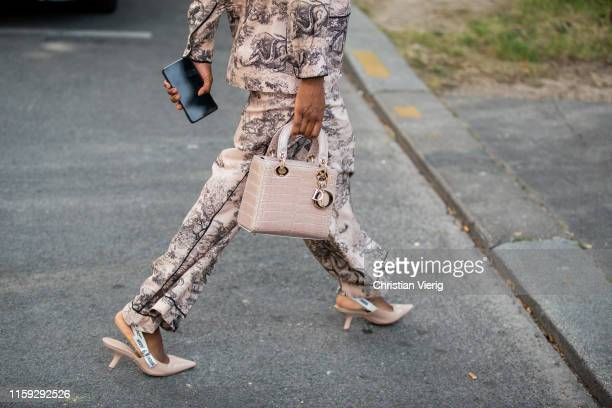 A guest is seen wearing Dior bag outside Redemption during Paris Fashion Week Haute Couture Fall/Winter 2019/2020 on June 30 2019 in Paris France