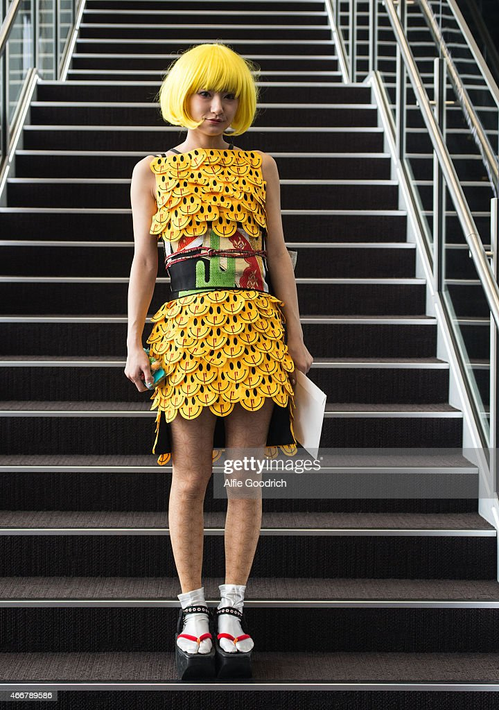 A guest is seen wearing dress by Dress Camp, vintage Japanese obi (waist-band) from Kyoto, socks by Avant Garde and shoes by K3 during the Mercedes Benz Fashion Week TOKYO 2015 A/W at Shibuya Hikarie on March 19, 2015 in Tokyo, Japan.