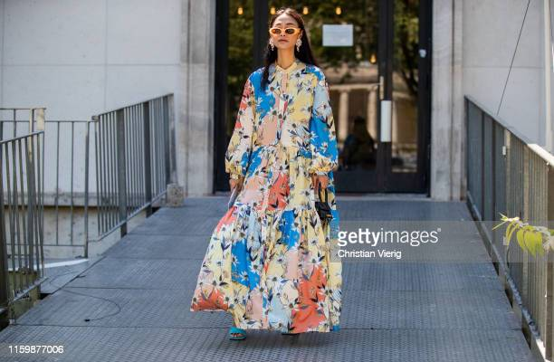 Guest is seen wearing dress with floral print outside Elie Saab during Paris Fashion Week - Haute Couture Fall/Winter 2019/2020 on July 03, 2019 in...