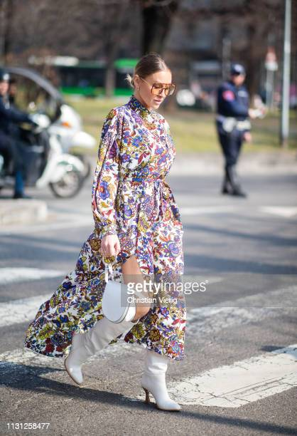 A guest is seen wearing dress with floral print outside Fendi on Day 2 Milan Fashion Week Autumn/Winter 2019/20 on February 21 2019 in Milan Italy
