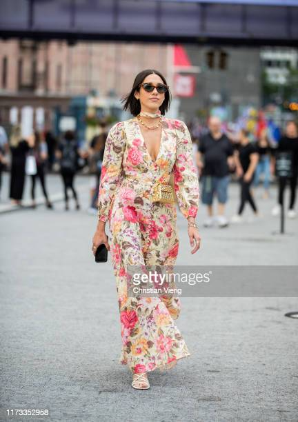 A guest is seen wearing dress with floral print outside Jason Wu during New York Fashion Week September 2019 on September 08 2019 in New York City