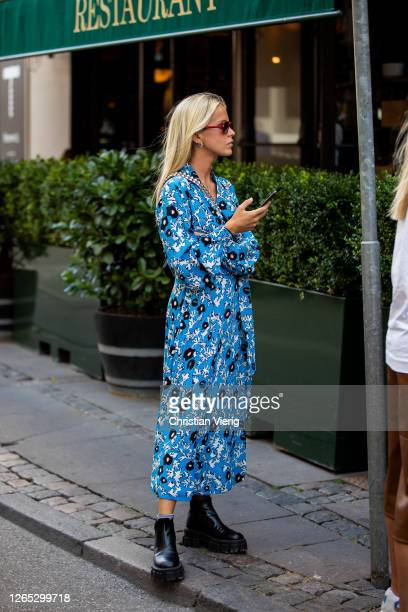 Guest is seen wearing dress with print outside Lovechild 1979 during Copenhagen Fashion Week Spring/Summer 2021 on August 11, 2020 in Copenhagen,...