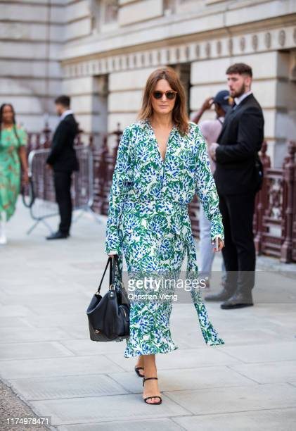 Guest is seen wearing dress with print outside Victoria Beckham during London Fashion Week September 2019 on September 15, 2019 in London, England.
