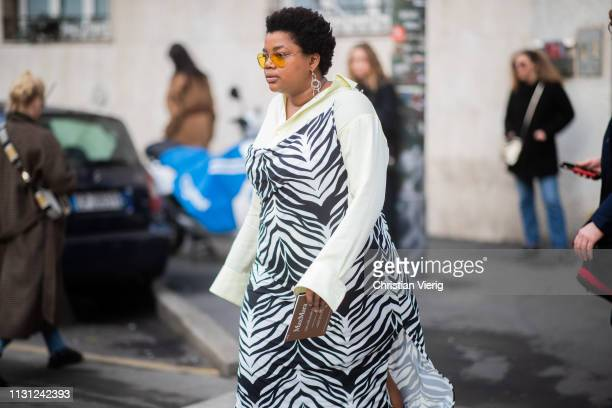 Guest is seen wearing dress with zebra print outside Max Mara on Day 2 Milan Fashion Week Autumn/Winter 2019/20 on February 21, 2019 in Milan, Italy.