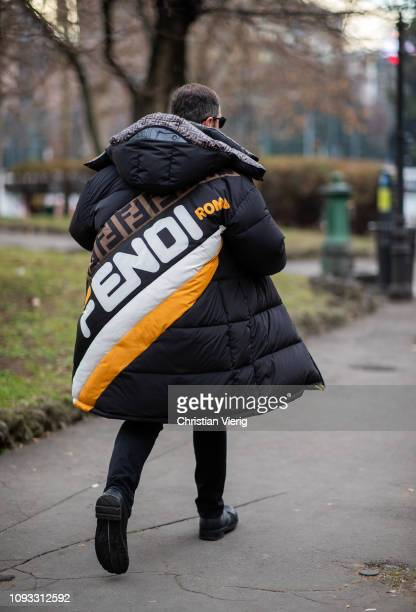 A guest is seen wearing Fendi down feather coat outside M1992 during Milan Menswear Fashion Week Autumn/Winter 2019/20 on January 12 2019 in Milan...