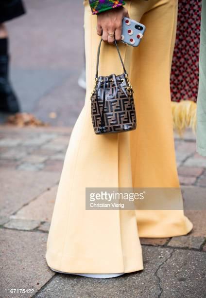 Guest is seen wearing flared pants, Fendi bag outside Saks Potts during Copenhagen Fashion Week Spring/Summer 2020 on August 08, 2019 in Copenhagen,...