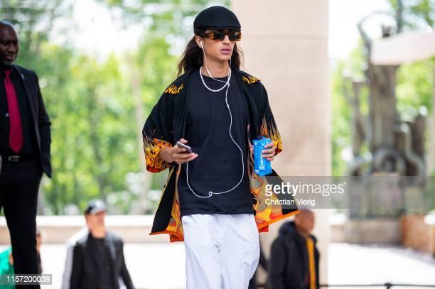 Guest is seen wearing flat cap outside Rick Owens during Paris Fashion Week - Menswear Spring/Summer 2020 on June 20, 2019 in Paris, France.