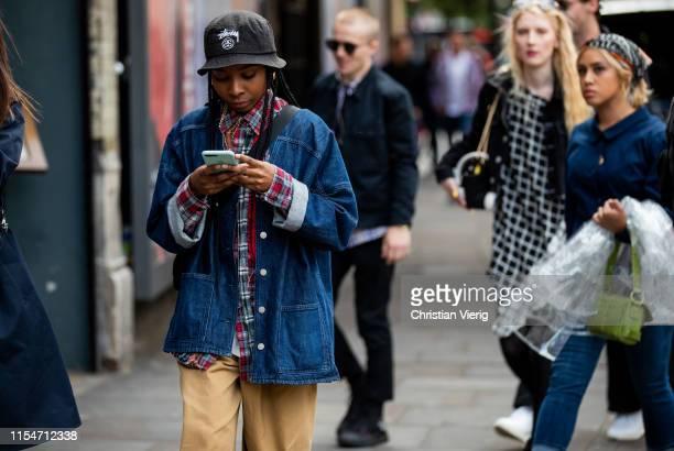 Guest is seen wearing floppy hat, denim jeans jacket outside John Lawrence Sullivan during London Fashion Week Men's June 2019 on June 08, 2019 in...