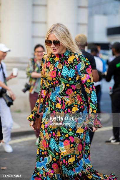 A guest is seen wearing floral print dress outside Victoria Beckham during London Fashion Week September 2019 on September 15 2019 in London England