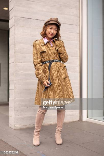 A guest is seen wearing gold coat brown cap black Dickies belt and nude thighhigh boots during the Amazon Fashion Week TOKYO 2019 S/S on October 20...
