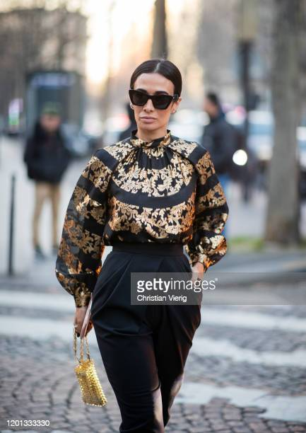 Guest is seen wearing golden black blouse and bag, black high waist pants outside Zuhair Murad during Paris Fashion Week - Haute Couture...