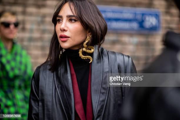 A guest is seen wearing golden dragon earring during MercedesBenz Tbilisi Fashion Week on November 3 2018 in Tbilisi Georgia