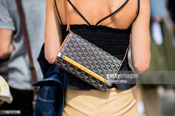 Guest is seen wearing Goyard bag outside Holzweiler during Copenhagen Fashion Week Spring/Summer 2020 on August 07, 2019 in Copenhagen, Denmark.