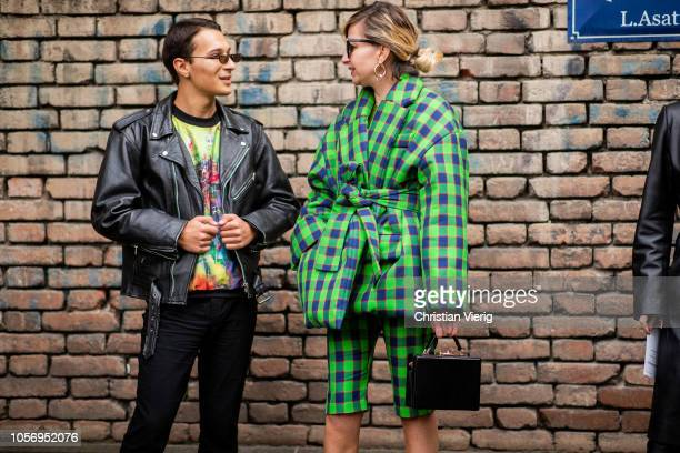 A guest is seen wearing green belted plaid puffer down feather jacket during MercedesBenz Tbilisi Fashion Week on November 3 2018 in Tbilisi Georgia