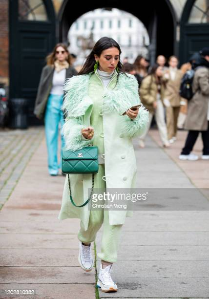 Guest is seen wearing green Chanel bag, coat and pants outside Mfpen during Copenhagen Fashion Week Autumn/Winter 2020 Day 2 on January 29, 2020 in...