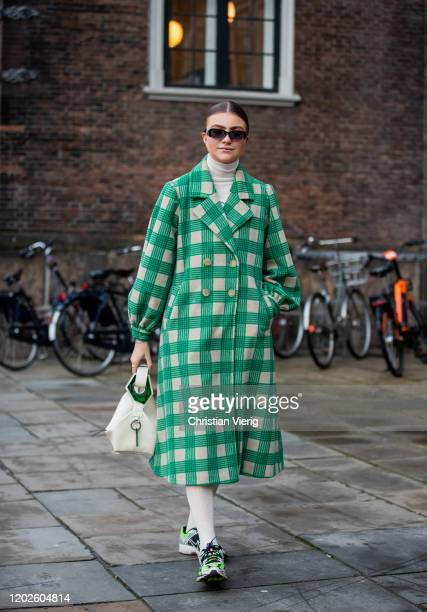 Guest is seen wearing green checkered coat outside Lovechild on Day 1 during Copenhagen Fashion Week Autumn/Winter 2020 on January 28, 2020 in...