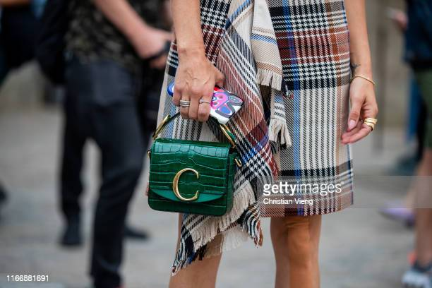 Guest is seen wearing green Chloe bag outside Designers Remix during Copenhagen Fashion Week Spring/Summer 2020 on August 08, 2019 in Copenhagen,...