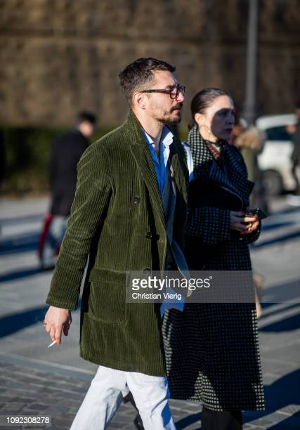A guest is seen wearing green corduroy jacket during the 95th Pitti Uomo at Fortezza Da Basso on January 10 2019 in Florence Italy