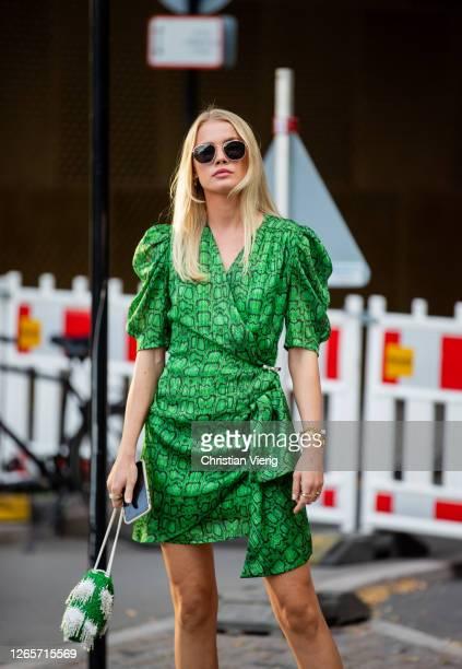 Guest is seen wearing green dress outside Henrik Vibskov during Copenhagen Fashion Week Spring/Summer 2021 on August 12, 2020 in Copenhagen, Denmark.