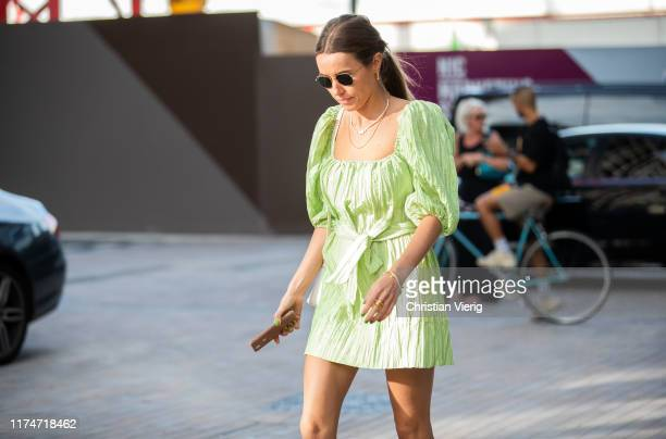 Guest is seen wearing green dress outside House of Holland during London Fashion Week September 2019 on September 14, 2019 in London, England.