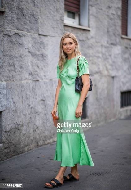 Guest is seen wearing green dress outside the Missoni show during Milan Fashion Week Spring/Summer 2020 on September 21, 2019 in Milan, Italy.