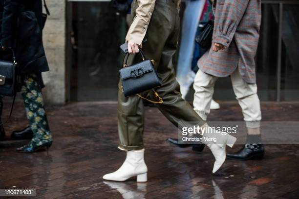 Guest is seen wearing green high waist pants, Valentino bag outside Roland Mouret during London Fashion Week February 2020 on February 16, 2020 in...
