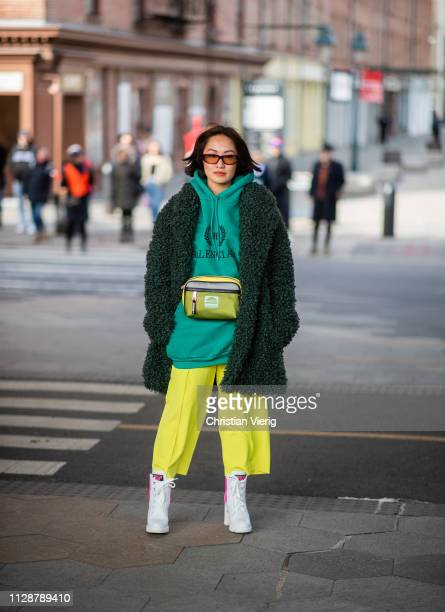 A guest is seen wearing green hoody belt bag cropped pants outside Tory Burch during New York Fashion Week Autumn Winter 2019 on February 10 2019 in...