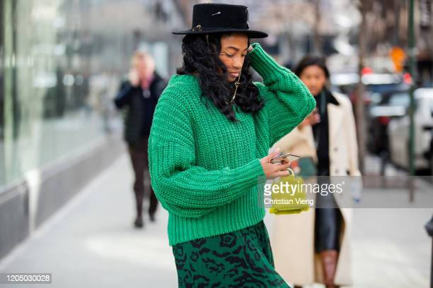 Guest is seen wearing green knit, black hat, skirt with print, mini bag outside Self-Portrait during New York Fashion Week Fall/Winter 20 on February...