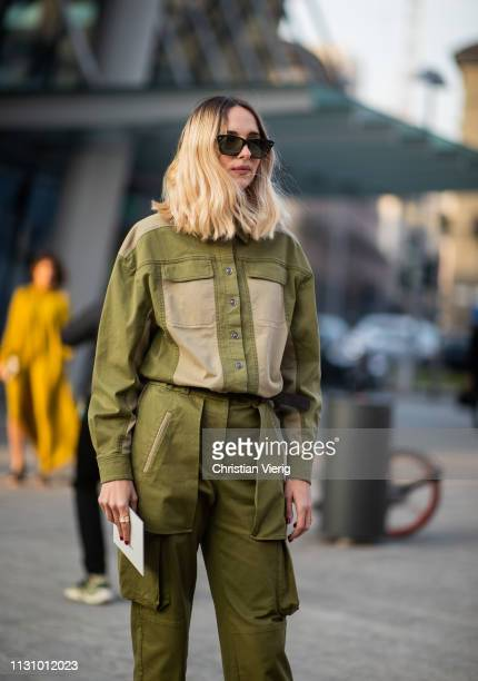 A guest is seen wearing green olive pants and jacket outside Alberta Ferretti on Day 1 Milan Fashion Week Autumn/Winter 2019/20 on February 20 2019...