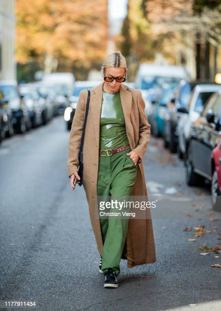 Guest is seen wearing green pants, beige trench coat outside Cédric Charlier during Paris Fashion Week Womenswear Spring Summer 2020 on September 28,...