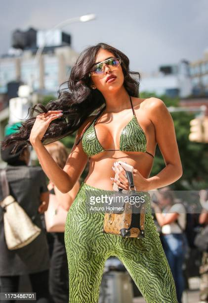 A guest is seen wearing green sequent outfit with brown Louis Vuitton bag during New York Fashion Week on September 09 2019 in New York City