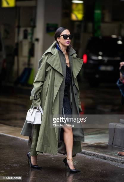 A guest is seen wearing green trench coat outside Sacai during Paris Fashion Week Womenswear Fall/Winter 2020/2021 Day Eight on March 02 2020 in...