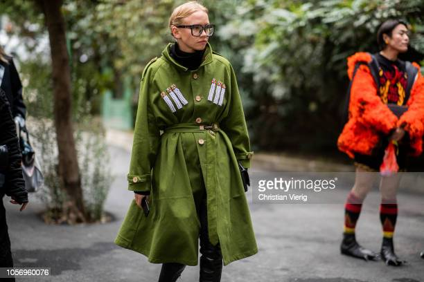 A guest is seen wearing green wool coat with patches glasses during MercedesBenz Tbilisi Fashion Week on November 3 2018 in Tbilisi Georgia