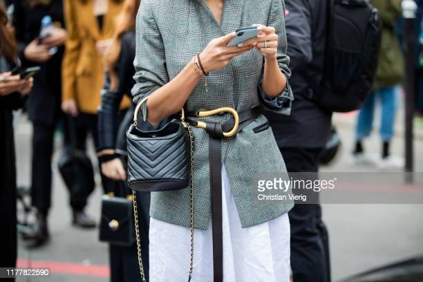 A guest is seen wearing grey belted blazer Chanel bag outside Haider Ackermann during Paris Fashion Week Womenswear Spring Summer 2020 on September...