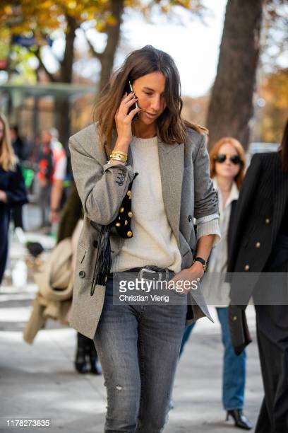 Guest is seen wearing grey blazer outside Sacai during Paris Fashion Week Womenswear Spring Summer 2020 on September 30, 2019 in Paris, France.