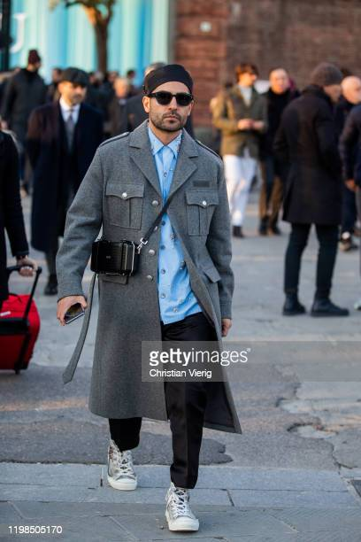 A guest is seen wearing grey coat during Pitti Uomo 97 at Fortezza Da Basso on January 09 2020 in Florence Italy