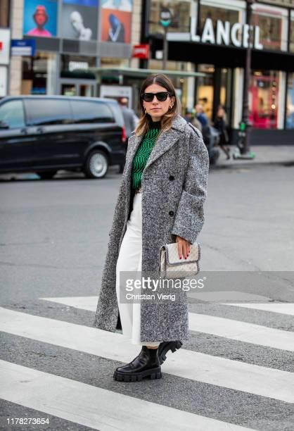 A guest is seen wearing grey coat outside Stella McCartney during Paris Fashion Week Womenswear Spring Summer 2020 on September 30 2019 in Paris...